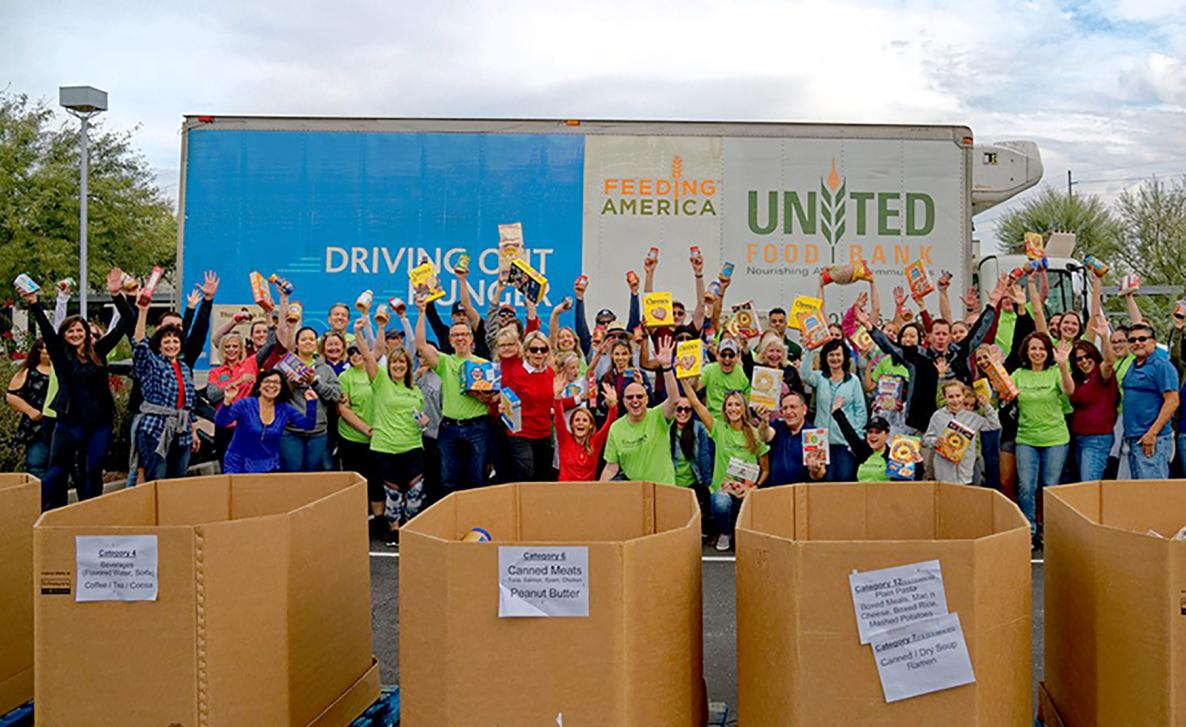 Edward Jones associates volunteer at a Feeding America United Food Bank corporate charity event.