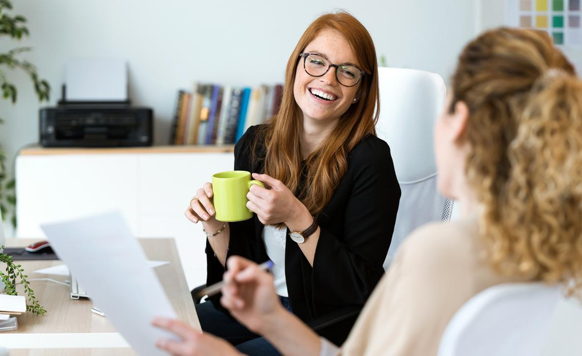 An Edward Jones client shares a laugh with their trusted financial advisor.