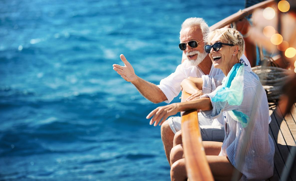 Two Edward Jones clients sit on a boat and enjoy retirement.
